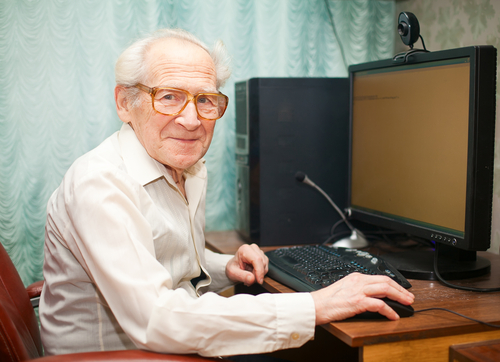 Old man at desktop compute