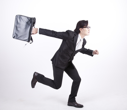 Businessman with briefcase dashing off