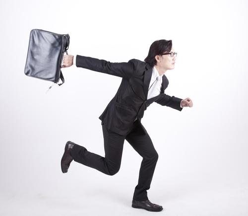 Businessman with briefcase dashing off