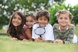 Group of children with magnifying glass