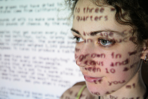 Woman with slide text projected on her face